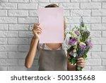 Female Florist Holding Paper...