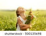 Happy Little Girl With Flowers...
