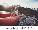 young woman canoeing in a lake. ... | Shutterstock . vector #500175715