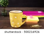 Yellow Cup Of Coffee With Whit...