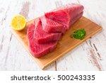 Raw Tuna Steak On Wooden...