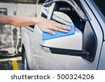 hand with blue microfiber cloth ... | Shutterstock . vector #500324206