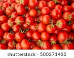 delicious red tomatoes. a pile... | Shutterstock . vector #500371432