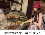 young woman buys fresh pastries ... | Shutterstock . vector #500420176