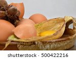 Small photo of Yolk and albumen. Eggs on a ceramic bowl, hazelnut. Egg.