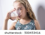 a happy smiling child drinking... | Shutterstock . vector #500453416