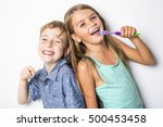 Two Cute Little Child Brushing...