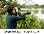 photographer shooting birds... | Shutterstock . vector #500464675