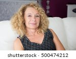 smiling senior woman sitting in ... | Shutterstock . vector #500474212