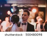 groom looks at the crowd while... | Shutterstock . vector #500480098