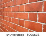 Looking along a red brick wall. - stock photo