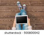 young girl using white tablet | Shutterstock . vector #500800042