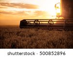 Combine Harvesting The Wheat O...