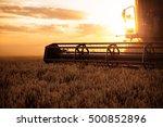 Combine Harvesting The Wheat O...