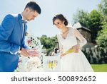 brides pour sand in vase | Shutterstock . vector #500892652