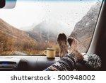 Woman Legs In Warm Socks On Car ...
