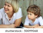 woman and little boy lying down ... | Shutterstock . vector #50099068