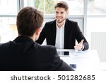 two cheerful young businessmen... | Shutterstock . vector #501282685