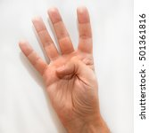 Small photo of Number four in the American Sign Language (ASL) shown with one hand and a finger