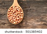 peanuts in wooden ladle on old... | Shutterstock . vector #501385402