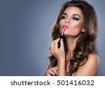 beautiful woman applying pink...   Shutterstock . vector #501416032