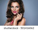 beautiful woman applying pink... | Shutterstock . vector #501416062