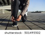 Guy Tying Shoe Laces Before A...