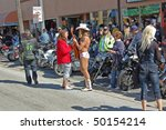 "DAYTONA BEACH, FL - MARCH 6:  The Naked Cowboy talking on Main Street amid the sea of bikers in town for ""Bike Week 2010"" in Daytona Beach, Florida on March 6, 2010. - stock photo"