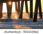 Sunset Waves Crashing On Pier