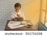 young businessmen sit across... | Shutterstock . vector #501731038