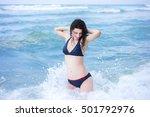happy girl on ocean beach.... | Shutterstock . vector #501792976