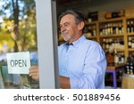 wine shop owner holding open... | Shutterstock . vector #501889456