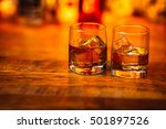 whiskey drinks on  wood in bar | Shutterstock . vector #501897526