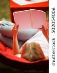 girl with notepad rests on red... | Shutterstock . vector #502054006