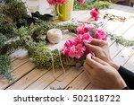 florist at work  creating a... | Shutterstock . vector #502118722