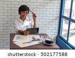 young businessmen sit across... | Shutterstock . vector #502177588