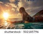 a surfer girl watching sunset... | Shutterstock . vector #502185796