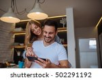 couple buying online on the... | Shutterstock . vector #502291192