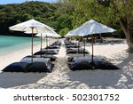 Small photo of White umbrella and air cushion seat on the beach in Thailand.