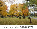 Cemetery In Fall With Foliage
