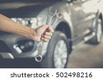 hand holding wrench.  auto... | Shutterstock . vector #502498216