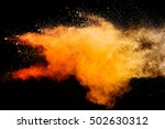 orange powder isolated on black ... | Shutterstock . vector #502630312