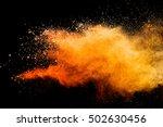orange powder isolated on black ... | Shutterstock . vector #502630456