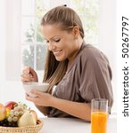 happy young woman eating... | Shutterstock . vector #50267797