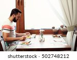 picture of young man sitting... | Shutterstock . vector #502748212