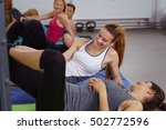 laughing group doing joga on... | Shutterstock . vector #502772596