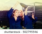 happy winery workers holding... | Shutterstock . vector #502795546