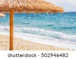 Sand Beach With Straw Sunshade...