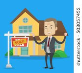 excited caucasian real estate... | Shutterstock .eps vector #503057452
