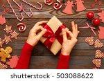 female hands on christmas gift...   Shutterstock . vector #503088622